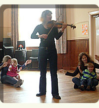 Jill Reeves playing the violin at music classes